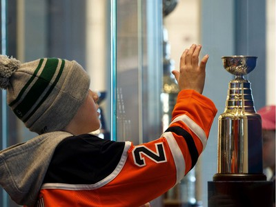 Hunter Hudson, seen looking over a mini Stanley Cup in the Edmonton Oilers Hall of Fame room, was one of 65 kids who signed a one-day contract and became an Edmonton Oiler during Boston Pizza's Oiler for a Day event held at Rogers Place in Edmonton, on Sunday, March 1, 2020.