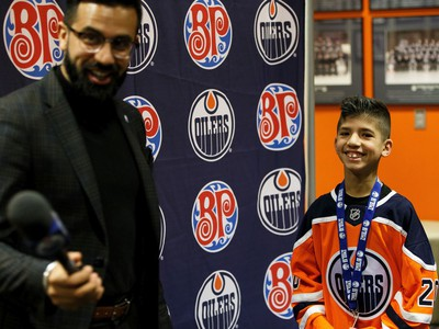 Sobhe Najmeddine (right) is interviewed by Tony Brar, Oilers Digital Content Producer & Reporter, during Boston Pizza's Oiler for a Day event held at Rogers Place in Edmonton, on Sunday, March 1, 2020.