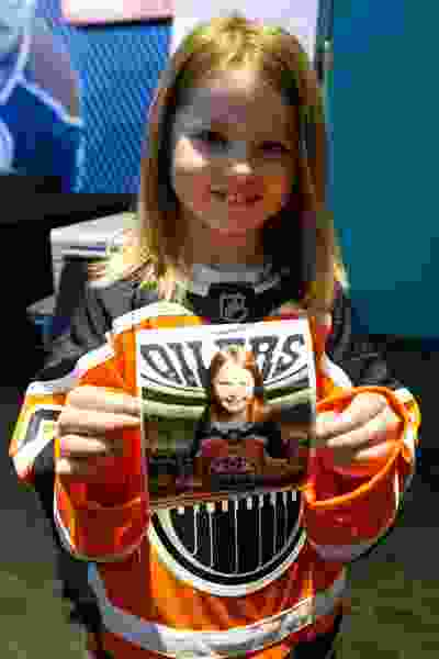 Newly minted Oiler for A Day Brinley Nelson holds her photo taken during Boston Pizza's Oiler for a Day event held at Rogers Place in Edmonton, on Sunday, March 1, 2020.