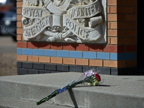 Flowers were placed outside RCMP K Division in Edmonton on Monday, April 20, 2020, for Const. Heidi Stevenson, who was killed by a gunman along with at least 18 people in Nova Scotia on April 18-19, 2020, in a senseless and random attack.