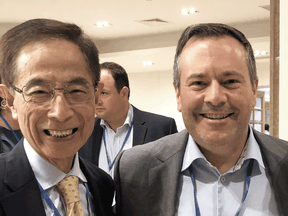 Hong Kong Democratic Party founder Martin Lee with Alberta Premier Jason Kenney.