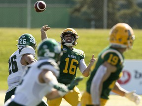 University Alberta Golden Bears quarterback Brad Launhardt (16) looks to pass to Tanner Buchanan (19) during first half Canada West action against the University of Saskatchewan Huskies at Foote Field on Sept. 21, 2019.