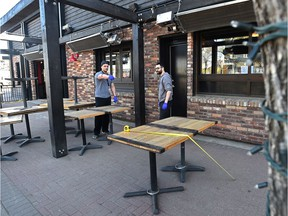 The staff at Hudsons pub on Whyte Avenue are preparing their patio on Wednesday, May 13, 2020, in preparation for the restriction to be eased on Thursday, May 14, 2020.