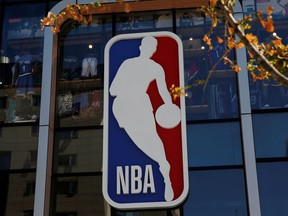 An NBA logo is seen on the facade of its flagship store at the Wangfujing shopping street in Beijing, China Oct. 8, 2019.