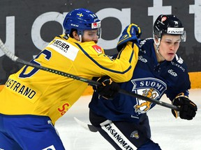 Sweden's Mikael Wikstrand skates against Finland's Jesse Puljujarvi in the Euro Hockey Tour's Karjala Cup on Finland Nov. 10, 2019.