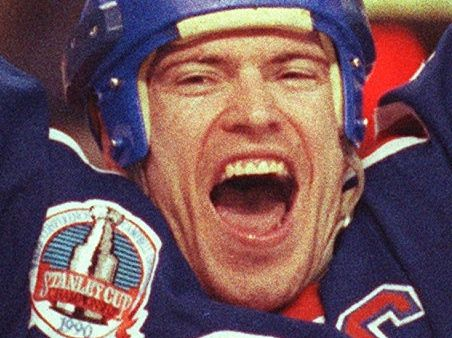 Edmonton Oilers captain Mark Messier hoists the Stanley Cup on May 24, 1990.