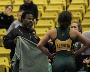 University of Alberta Golden Bears and Pandas wrestling head coach Owen Dawkins instructs one of his student-athletes during the 2019 Golden Bear Invitational at the Universiade Pavilion on Jan. 12, 2019.