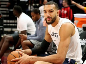 In this file photo taken on December 4, 2019 Utah Jazz center Rudy Gobert cools down after warm ups before a NBA game against Los Angeles Lakers in Salt Lake City, Utah.