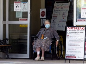 A woman exits the front door of the Good Samaritan Society Southgate Care Centre, 4225 107 St., on July 29, 2020. Several deaths have now been linked to a COVID-19 outbreak at the care home.