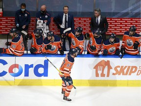EDMONTON, ALBERTA - AUGUST 03: Connor McDavid #97 of the Edmonton Oilers celebrates with his teammates after scoring a goal against Corey Crawford #50 of the Chicago Blackhawks during the first period in Game Two of the Western Conference Qualification Round prior to the 2020 NHL Stanley Cup Playoffs at Rogers Place on August 03, 2020 in Edmonton, Alberta.