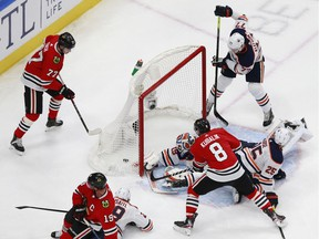 Mikko Koskinen #19 of the Edmonton Oilers allows a goal to Jonathan Toews #19 of the Chicago Blackhawks during the first period in Game 3 of the Western Conference Qualification Round at Rogers Place on August 05, 2020.