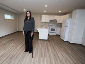 Patricia Thomas stands in her new home in the new supportive housing facility in Belvedere where the builders, Niginan, hope to change the way at-risk families are supported