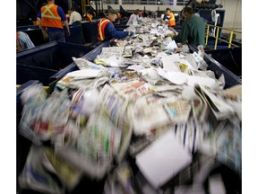 Plastics, paper and cans are seperated mechanically and by hand at the Edmonton Waste Management Centre. File photo.