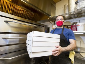 The Vegas Golden Knights hockey team donated dozens of pizzas to Boyle Street while they were in the Edmonton Bubble. Since then there fans have raised enough money to donate 591 pizzas. Robert Caruso, owner of Panini's Italian Cucina, is the one making the pizza. Taken on Thursday, Sept. 24, 2020 in Edmonton.  Greg Southam-Postmedia