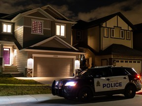 Edmonton Police Service officers investigate a suspicious death in a home at 17204 47 Street on Wednesday, Oct. 14, 2020. in Edmonton, on Wednesday, Oct. 14, 2020. Police entered the home at 10:30 am and continued to investigate into the night.