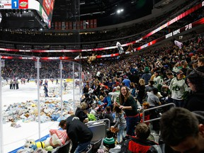 Fans throw teddy bears on the ice after Davis Koch of the Edmonton Oil Kings scored against the Prince Albert Raiders during the 2017 Teddy Bear Toss at Rogers Place on Dec. 2, 2017. Just how many fans will be allowed in the stands in 2021 remains to be seen.