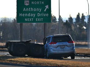 Police investigate a collision between a eight-wheel converter dolly that separated off a semi-trailer truck and hit the driver's side of  a vehicle on Lessard Road overpass near the Anthony Henday Drive on Wednesday, Oct. 28, 2020.