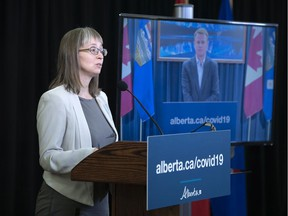 Alberta's chief medical officer of health Dr. Deena Hinshaw attends a COVID-19 update with Health Minister Tyler Shandro appearing remotely.