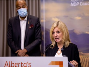 Alberta NDP Leader Rachel Notley, right, and David Shepherd, NDP Opposition health critic, respond to a COVID-19 update from Premier Jason Kenney, Health Minister Tyler Shandro and Alberta chief medical officer of health Dr. Deena Hinshaw during a press conference at the Federal Building in Edmonton on Nov. 12, 2020.