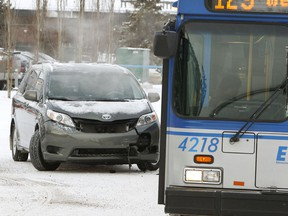 A non-injury fender bender is seen between a mini van and an ETS bus in Edmonton. File photo.