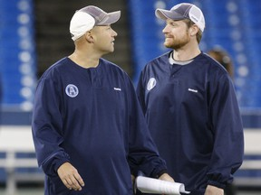 Coaches Scott Milanovich, left, and Mike O'Shea run Toronto Argonauts practice at Rogers Centre on Nov. 15, 2012, in preparation for the East Division semi-final in Montreal.