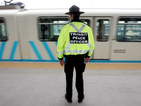 A transit peace officer watches an LRT train pull out of the Century Park South LRT station, file photo.