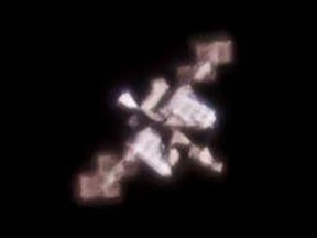 The SpaceX Dragon capsule is the bright white cone on the left of the ISS. Shafqat Zaman captured this shot with a camera mounted to a telescope on Nov 25.