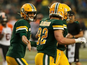 Edmonton quarterback Trevor Harris (7) celebrates a touchdown with receiver Greg Ellingson (82) against the B.C. Lions at Commonwealth Stadium on June 21, 2019.