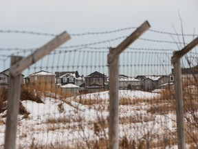 The former Domtar site is seen fenced off due to industrial contamination along Hermitage Road in northeast Edmonton, on Saturday, Dec. 5, 2020. Photo by Ian Kucerak