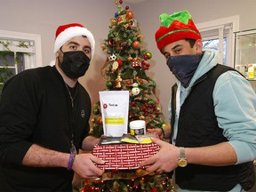 Brothers Ahmed and Ahsen with some of the popular items at Mt. Kushmore Cannabis Dispensary during the Christmas season in Calgary on Tuesday, Dec. 22, 2020.