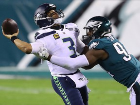 Javon Hargrave of the Philadelphia Eagles pressures Russell Wilson of the Seattle Seahawks during the second quarter at Lincoln Financial Field on November 30, 2020 in Philadelphia.