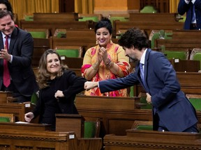 Finance Minister Chrystia Freeland receives a fist-bump from Prime Minister Justin Trudeau after unveiling her first fiscal update Monday, Nov. 30.
