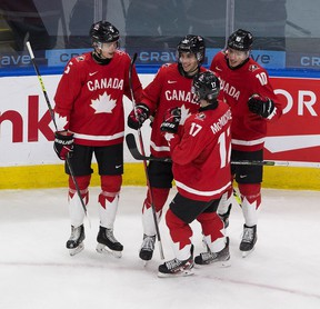Canada's Dylan Cozens (22) celebrates