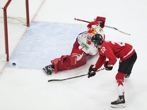 Canada's Dylan Cozens (22) misses a penalty shot on Russia's Yaroslav Askarov (1) during second period IIHF World Junior Hockey Championship semifinal action on Monday, Jan. 4, 2021 in Edmonton.