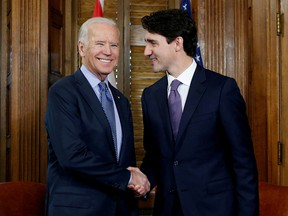 Prime Minister Justin Trudeau (right) shakes hands with Joe Biden during a meeting on Parliament Hill in Ottawa, December 9, 2016.