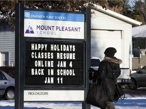 A sign outside Mount Pleasant School, 10541 60A Ave. advertises the dates for at home learning, in Edmonton Tuesday Jan. 5, 2021. Some students will return to in-school learning next week. Photo by David Bloom