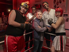 Vance Banzo, Tim Blair, Guled Abdi and Franco Nguyen surround executive producer/director Bruce McCulloch.
