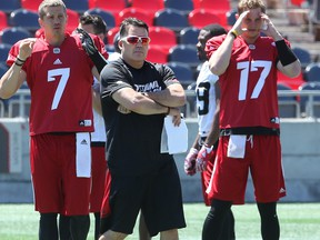 Offensive co-ordinator Jaime Elizondo is seen working with quarterback Trevor Harris (left) during Ottawa Redblacks practice in this file photo from June 26, 2017, at TD Place.