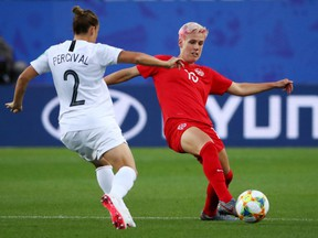 Canada's Sophie Schmidt in action with New Zealand's Ria at the Percival Stade des Alpes, Grenoble, France on June 15, 2019.