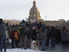 Anti-mask protestors during a rally at the Alberta legislature on Saturday, Feb. 20, 2021 in Edmonton.