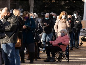 Hundreds of people with vaccination appointments queued outside of an Alberta Health Services clinic at Skyview Power Centre in Edmonton, on Thursday, Feb. 25, 2021.