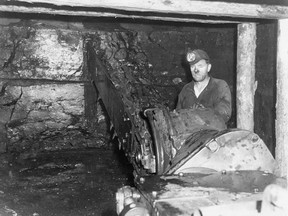 A miner operates an Anderson Boys Universal Coal Cutter in Galt No. 8 mine at Lethbridge. Credit: Sir Alexander Galt Museum and Archives.