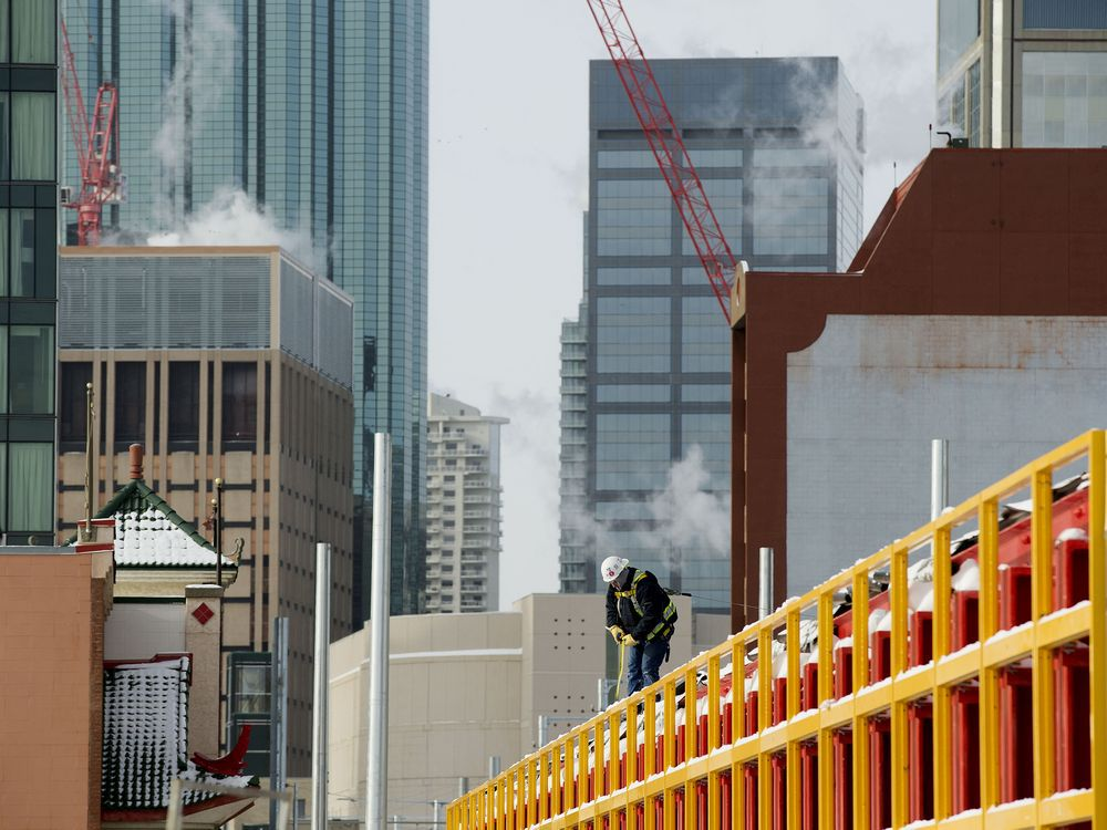 A crew member works on top of the 102 Avenue tunnel approach for the Valley LRT Line in Edmonton on Feb. 10, 2021.