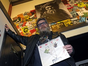 """Dave Bacon, a member of the band SNFU, at The Starlite Room in downtown Edmonton, with the band's album """"If You Swear You'll Catch No Fish"""", which was released 35 years ago."""