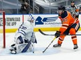 Edmonton Oilers Connor McDavid (97) is stopped by Toronto Maple Leafs goaltender Michael Hutchinson during third period NHL action at Rogers Place in Edmonton, on Monday, March 1, 2021.