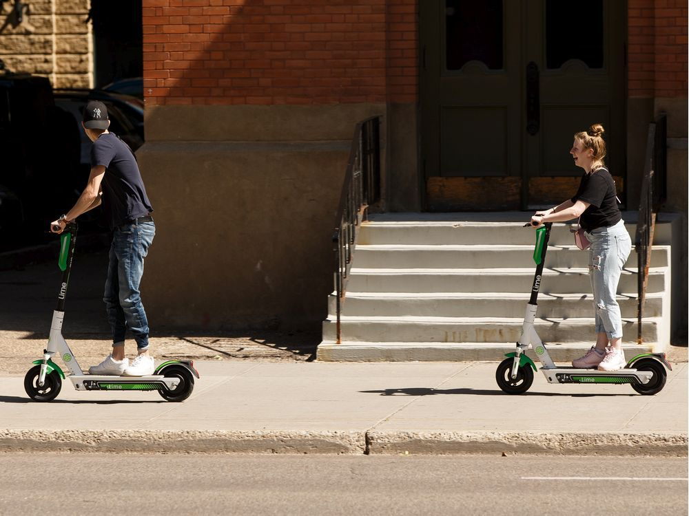 Edmonton to crack down on illegal e-scooter sidewalk use with $100 fines
