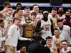 Aher Uguak (30) and the Loyola University of Chicago Ramblers pose for a team photo after defeating the Drake University Bulldogs in the finals of the Missouri Valley Conference Tournament at Enterprise Center in St. Louis on Mar 7, 2021.