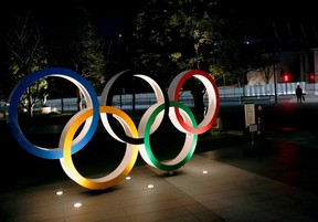 FILE PHOTO: The Olympic rings are illuminated in front of the National Stadium in Tokyo, Japan January 22, 2021. REUTERS/Kim Kyung-Hoon//File Photo ORG XMIT: FW1