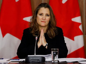 FILE PHOTO: Canada's Deputy Prime Minister and Minister of Finance Chrystia Freeland speaks to news media before unveiling her first fiscal update, the Fall Economic Statement 2020, in Ottawa, Ontario, Canada November 30, 2020.