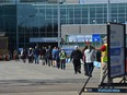 Lineups formed later in the morning for the COVID vaccine on the first day of a lower age group eligibility at the EXPO Centre in Edmonton, April 20, 2021. Ed Kaiser/Postmedia